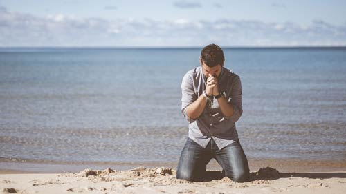 Man praying to God for more holiness
